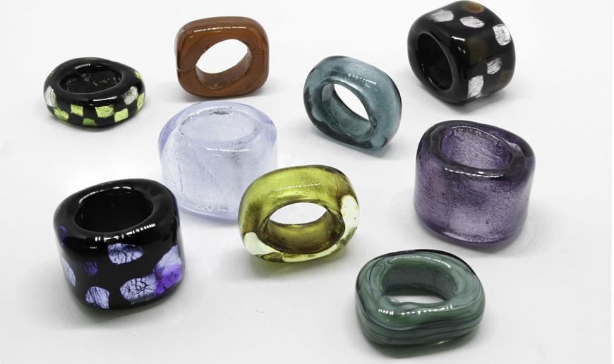 Glass sliders for regaliz cord